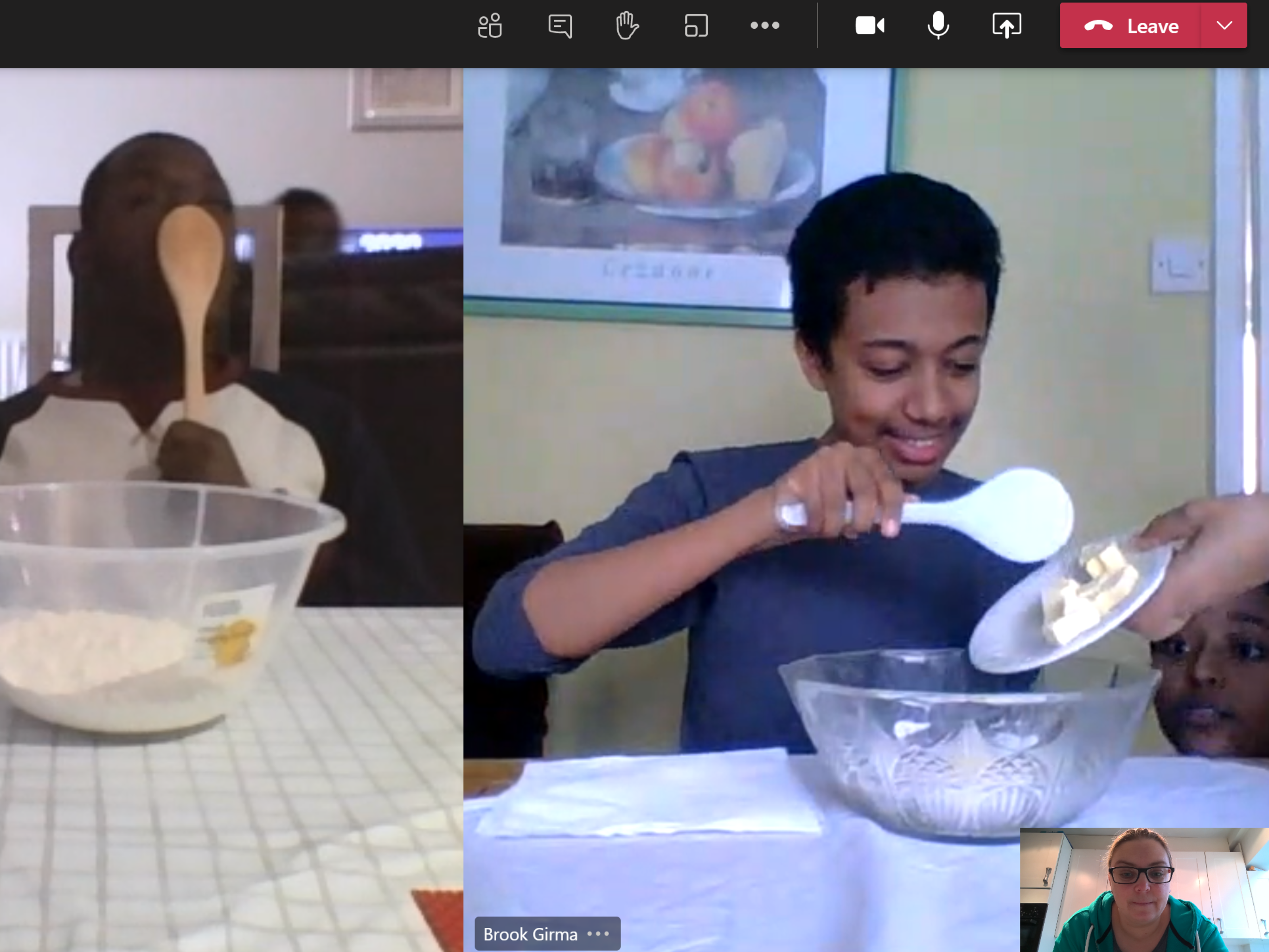 Two boys cooking online with an image of their teacher at the corner of the screen