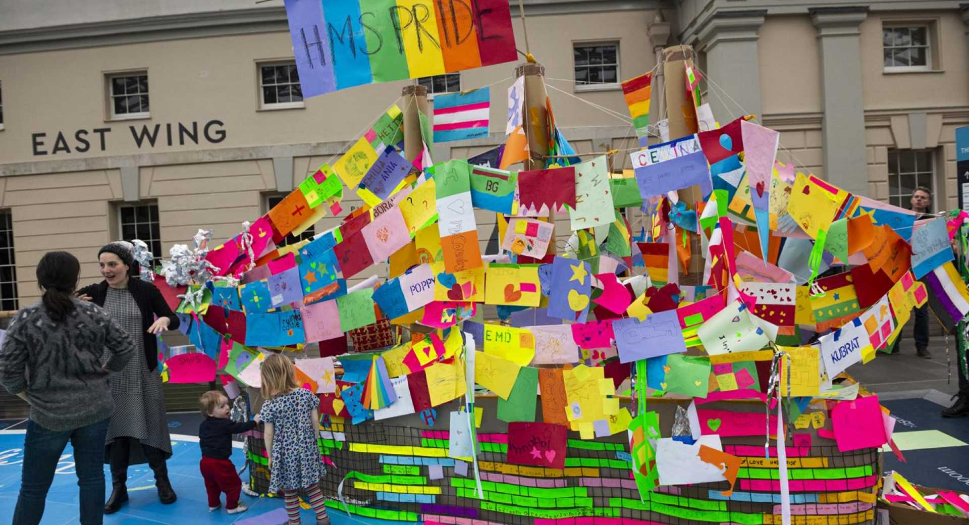 Multicolour boat with artwork and notes pasted on it