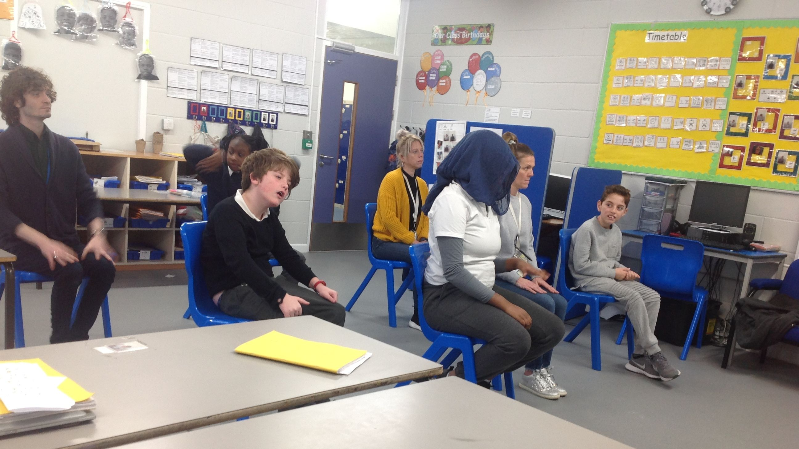 Students in a class sitting socially distanced