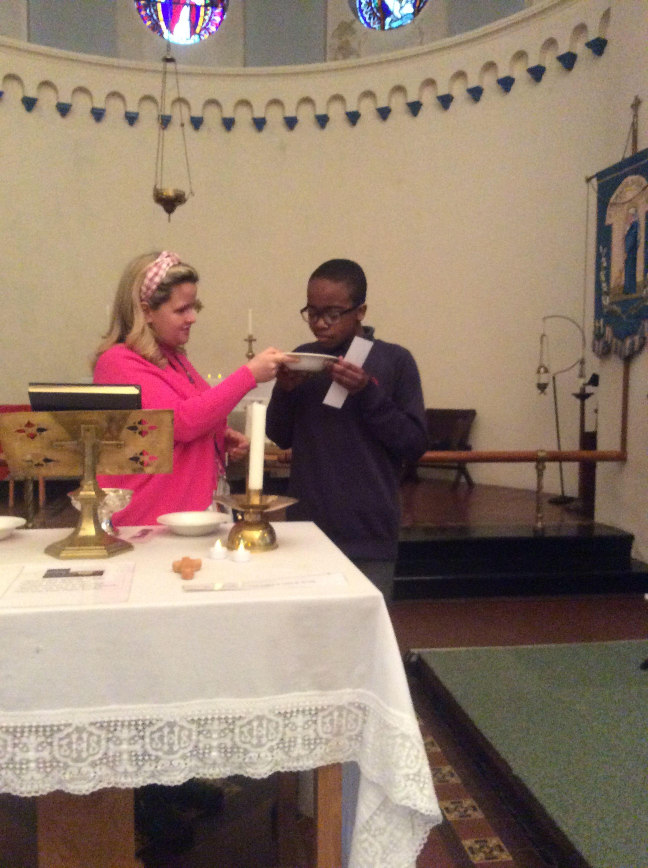 Boy and teacher in church