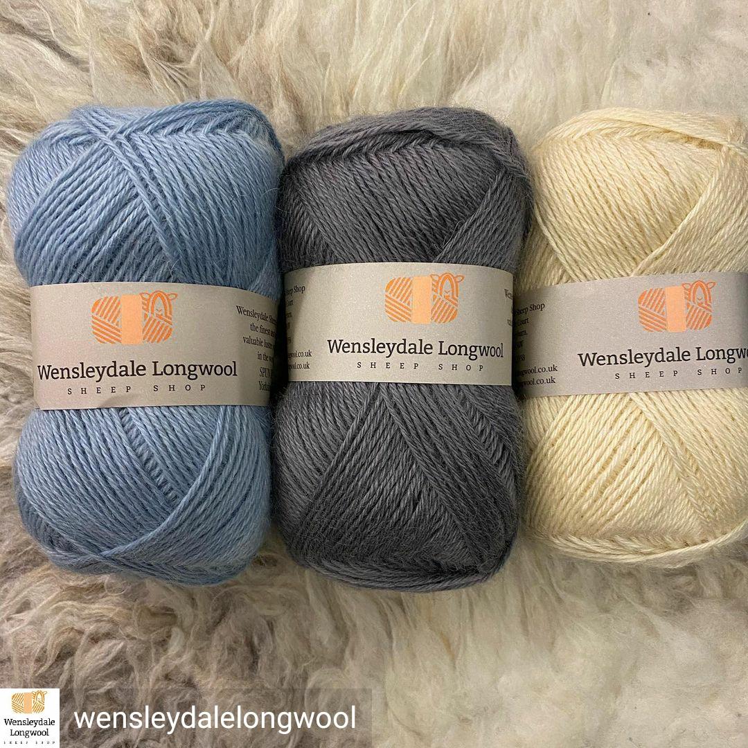 Wensleydale wool in balls on a sheepskin