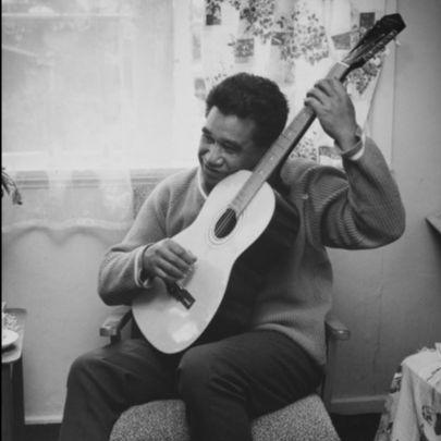 Hone Tuwhare with guitar. Courtesy Hone Tuwhare Trust.