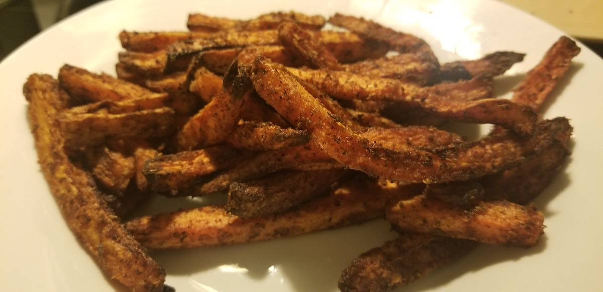 Plate of freshly cooked carrot fries.