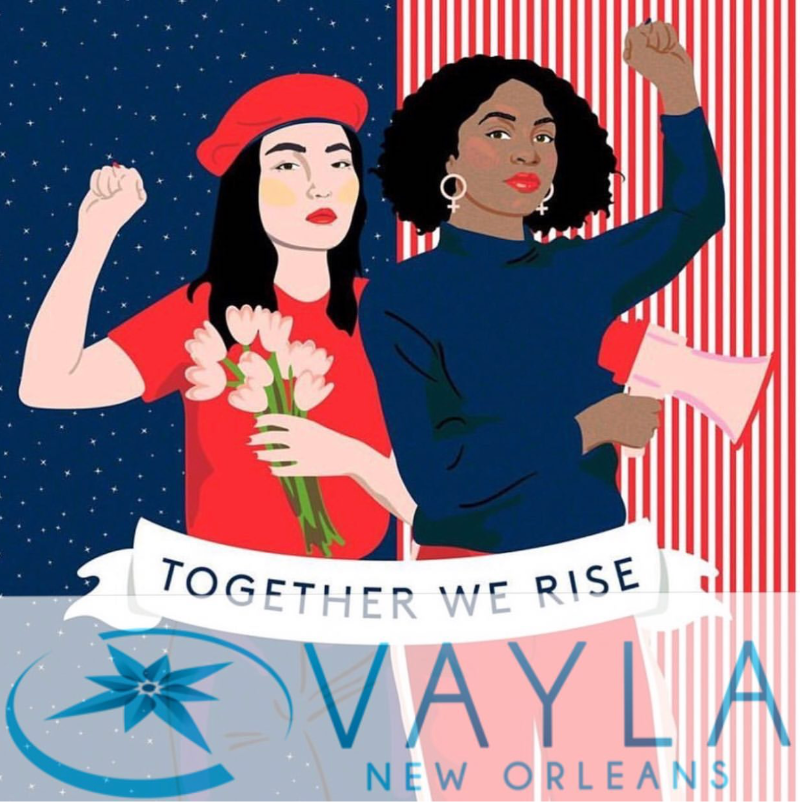 graphic of asian woman and black woman holding up fists. left woman is holding bouquet of pink flowers and right woman is holding megaphone. a banner in front says 'together we rise'. the backdrop behind the left woman is blue sky with stars, the right side is vertical red and white stripes.
