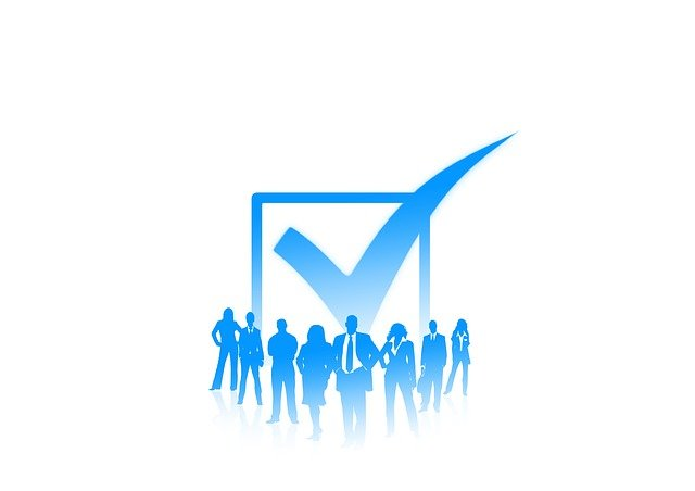 Stylized illustration of business people next to a blue check box