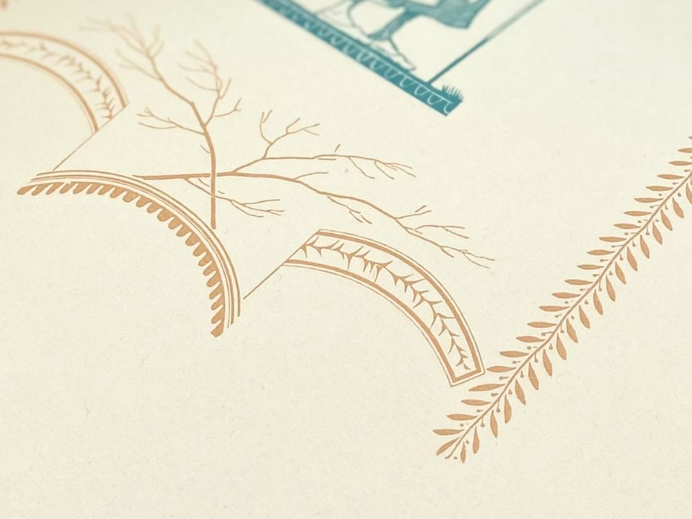 Detail of Dwiggins ornament in coral
