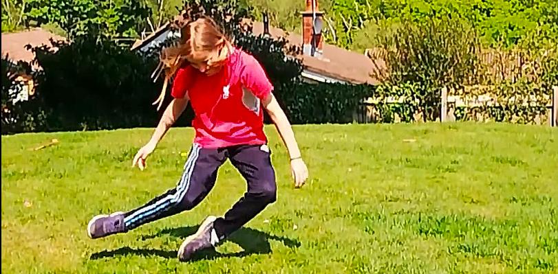 Picture of a girl dancing in her garden.
