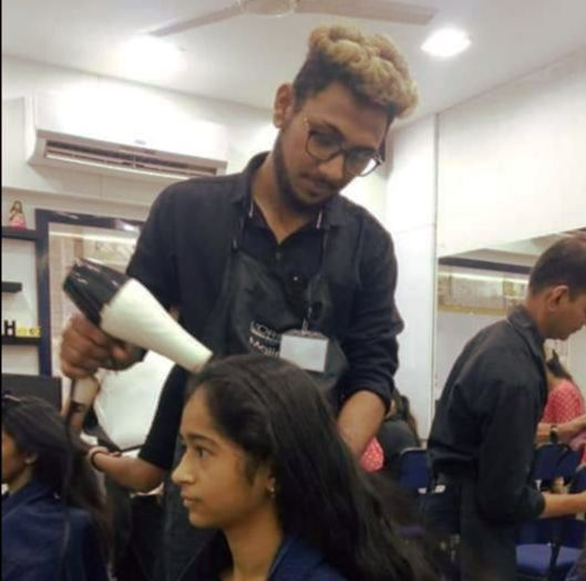 Hairdressing school student completing the course
