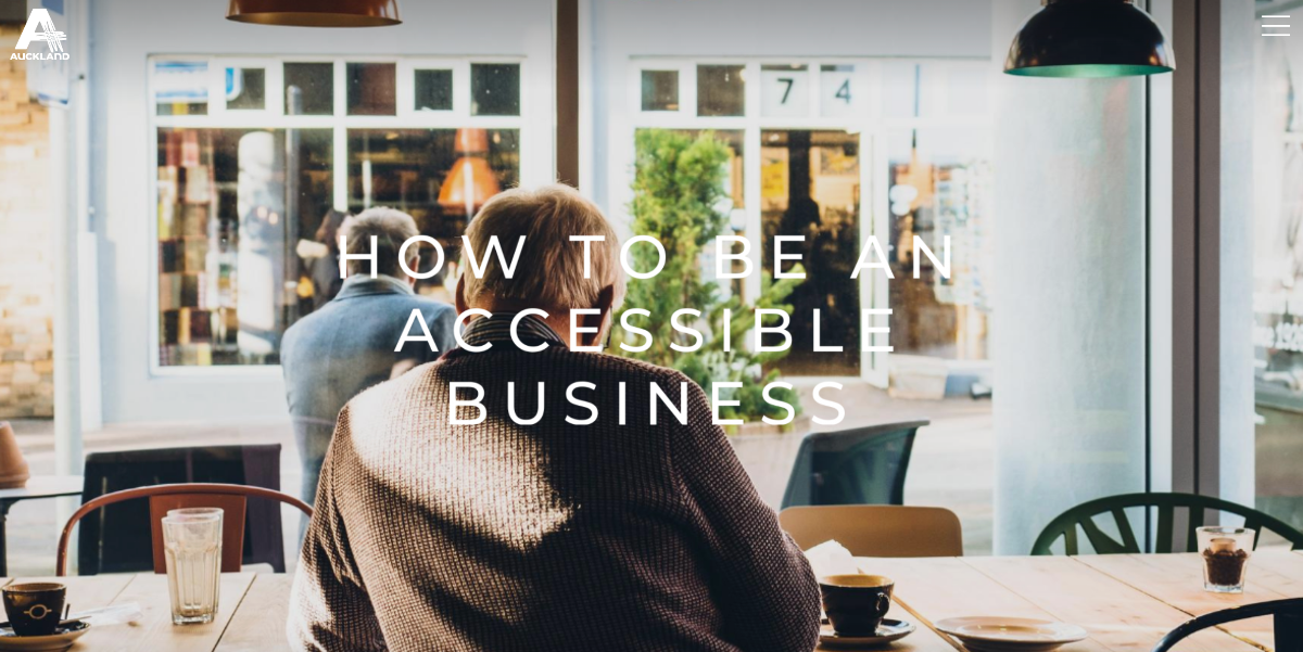 A man sitting at a cafe with his back to the camera - with overlaid text reading 'how to be an accessible business'