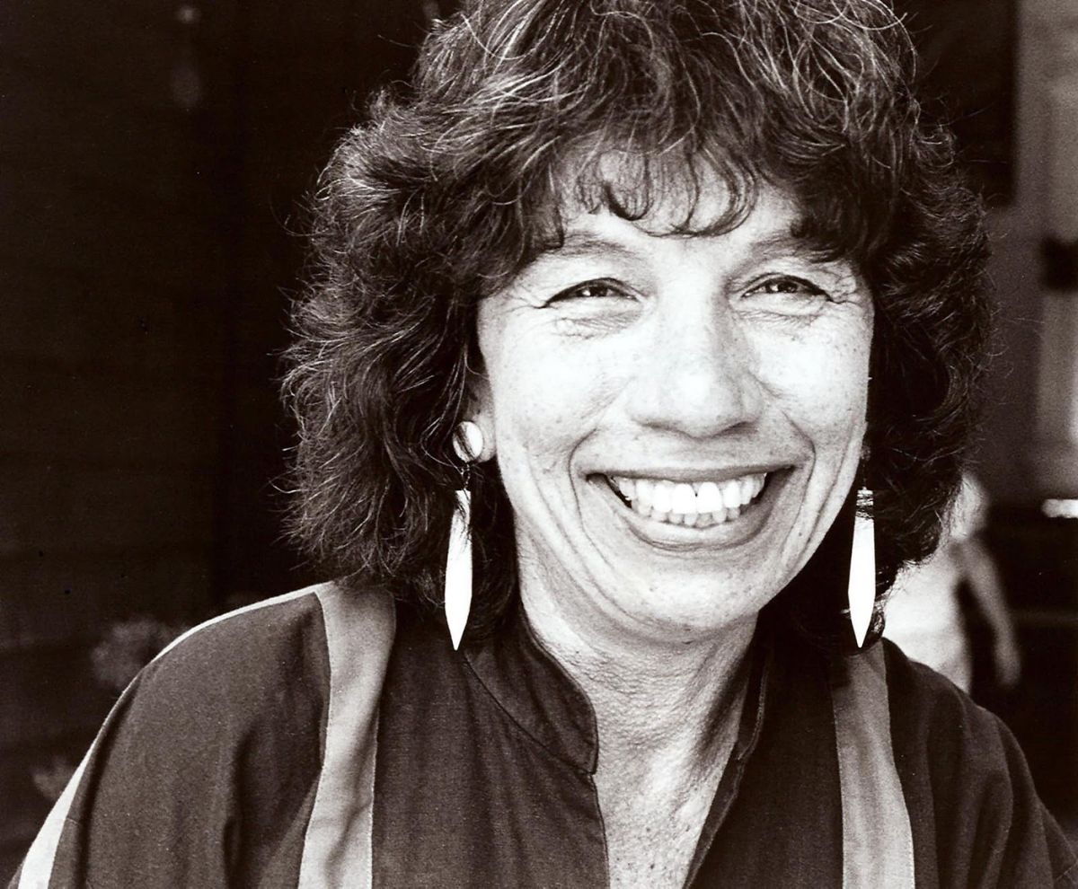 Black and white photo of Elizabeth 'Betita' Martinez looking at the camera, smiling warmly and broadly.
