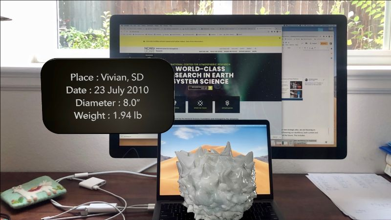 An augmented reality hailstone sits on a desk.