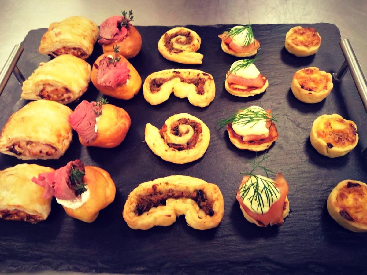 A board of five different savoury canapes