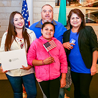 Newly naturalized family posing.