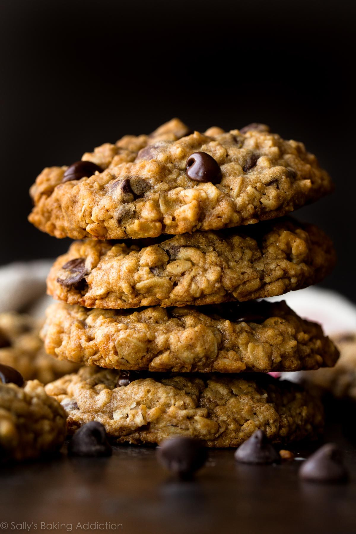 A stack of delicious oatmeal chocolate chip cookies.
