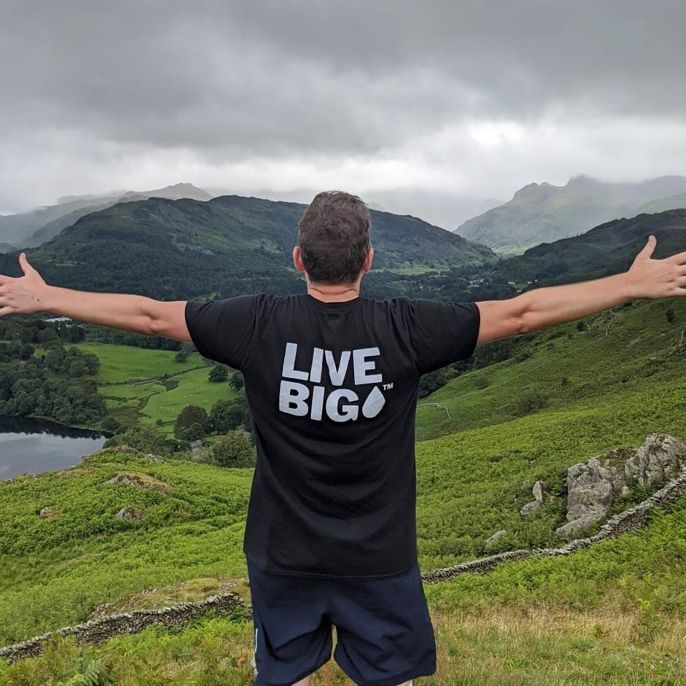 Living Big - picture of a man in a Big Drop t-shirt