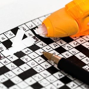 Crossword with pen and ink eraser