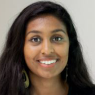 A headshot of a young woman called Devina from PwC