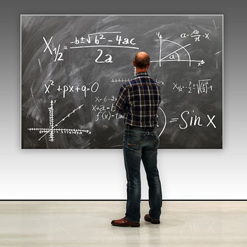 Maths teacher at blackboard