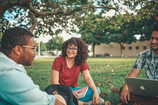 Students sitting in a park