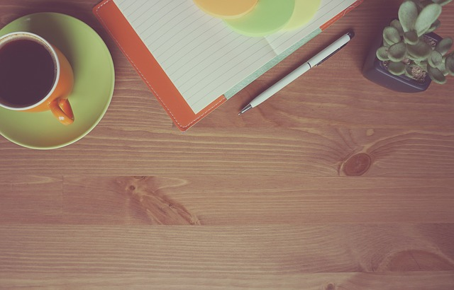 Coffee and notepad on a table