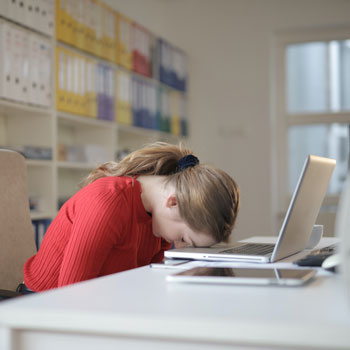 Unmotivated employee at desk