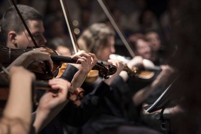 Image of violinists playing music