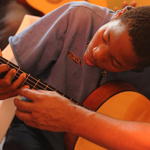 A boy playing a guitar