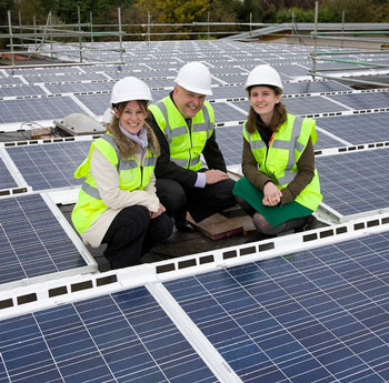 Three people on solar panels