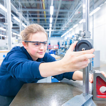 Young person doing a manufacturing apprenticeship in a factory