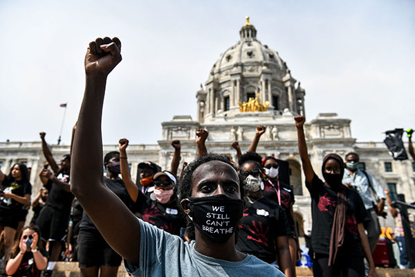 Demonstrators raise their fists outside the State Capitol of Minnesota during a protest over the death of George Floyd.