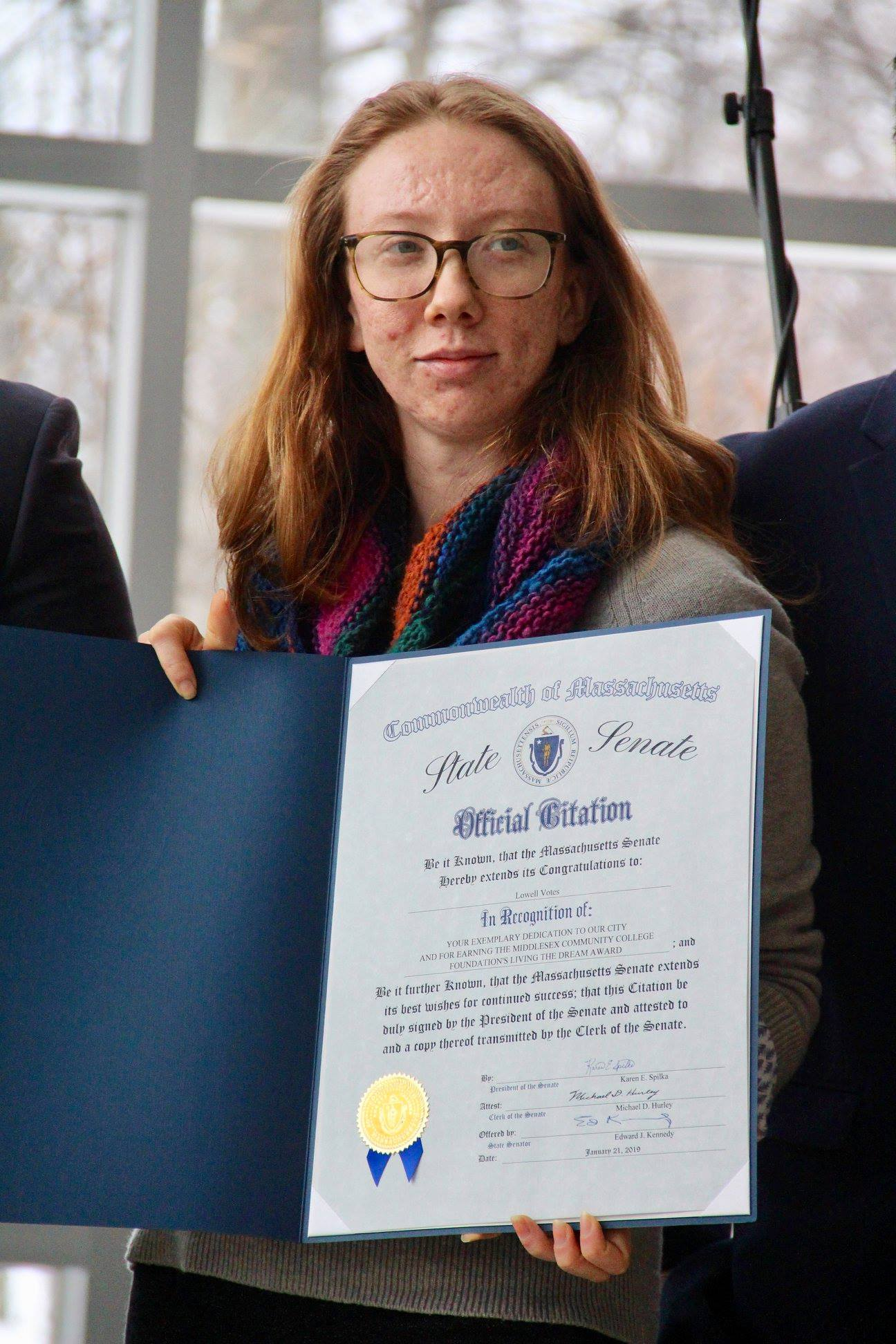 Mary accepting an award