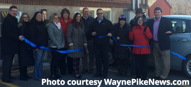 Ribbon cutting at the EV Charger station.