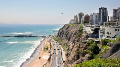 Buildings of Lima, Peru, on a bluff overlooking a highway next to the ocean