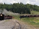 A train travels down the tracksDescription automatically generated with medium confidence