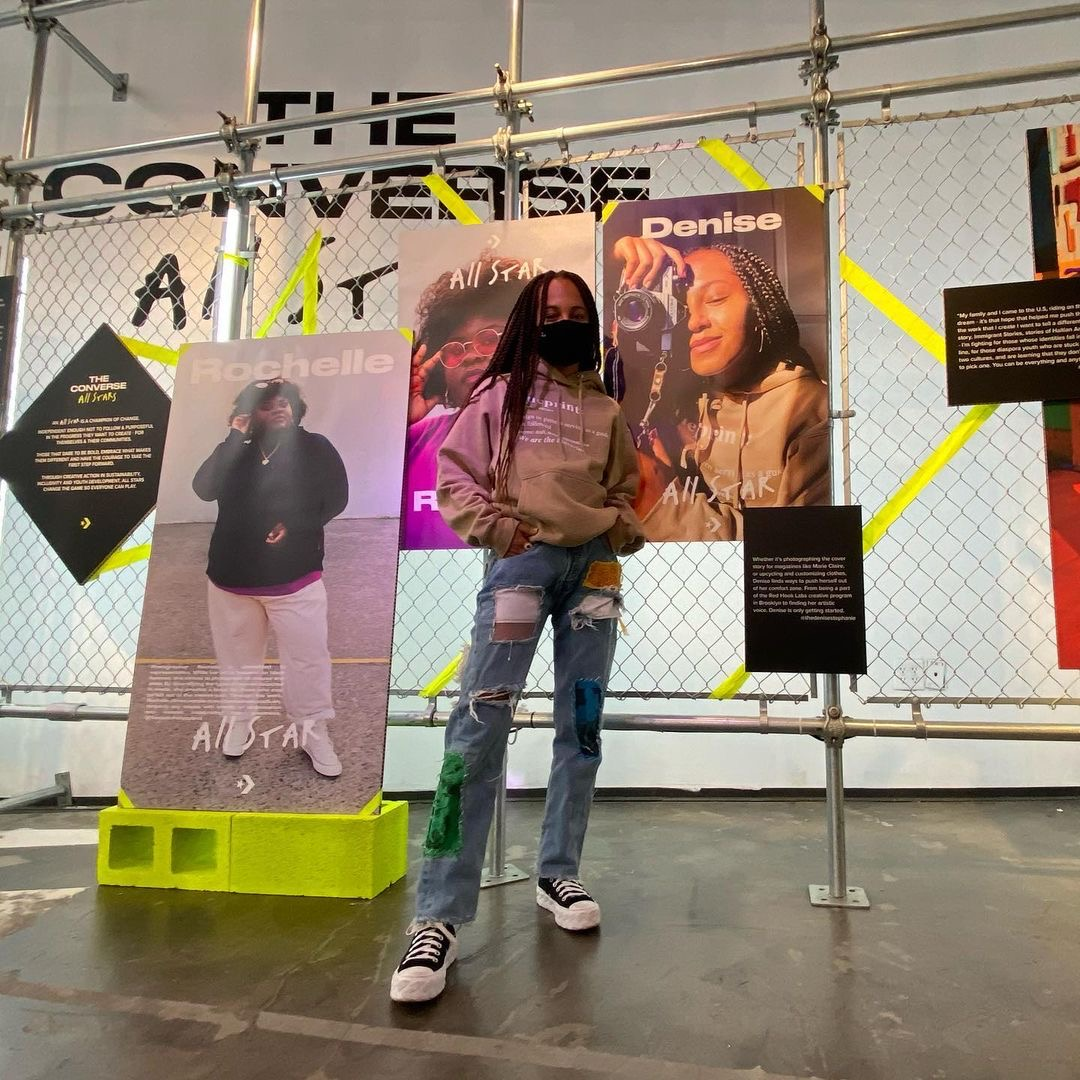 image of girl standing with jeans in a converse store