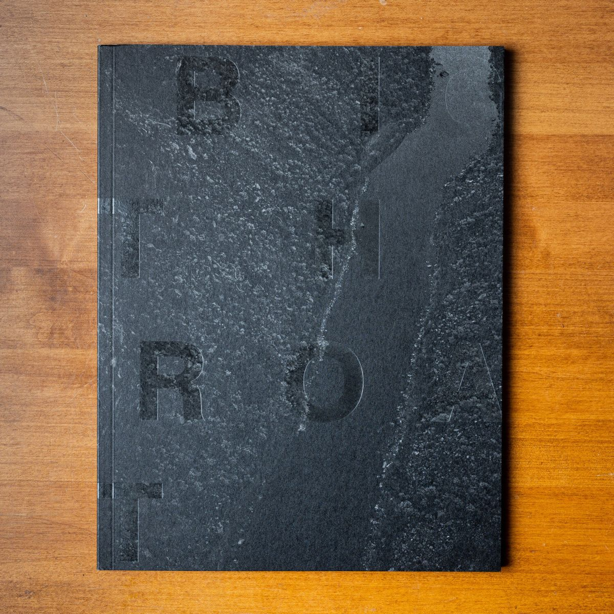 Black book cover with letters B, T, H, R, O, T scattered on the cover