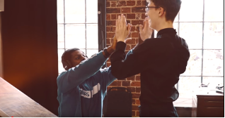 Two people high-fiving