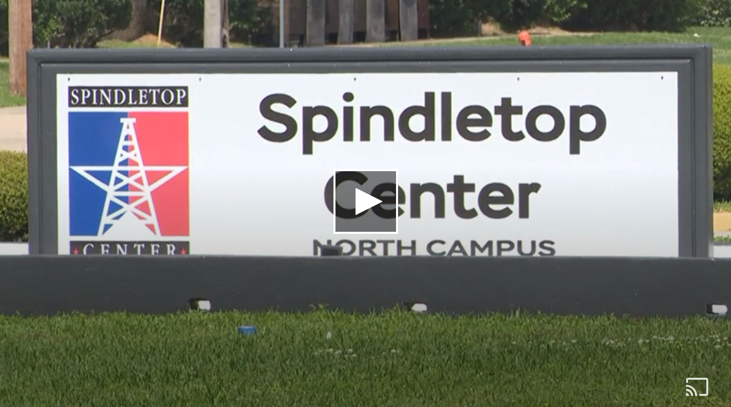 """White sign that reads """"Spindletop Center North Campus"""" with the Spindletop Center logo"""