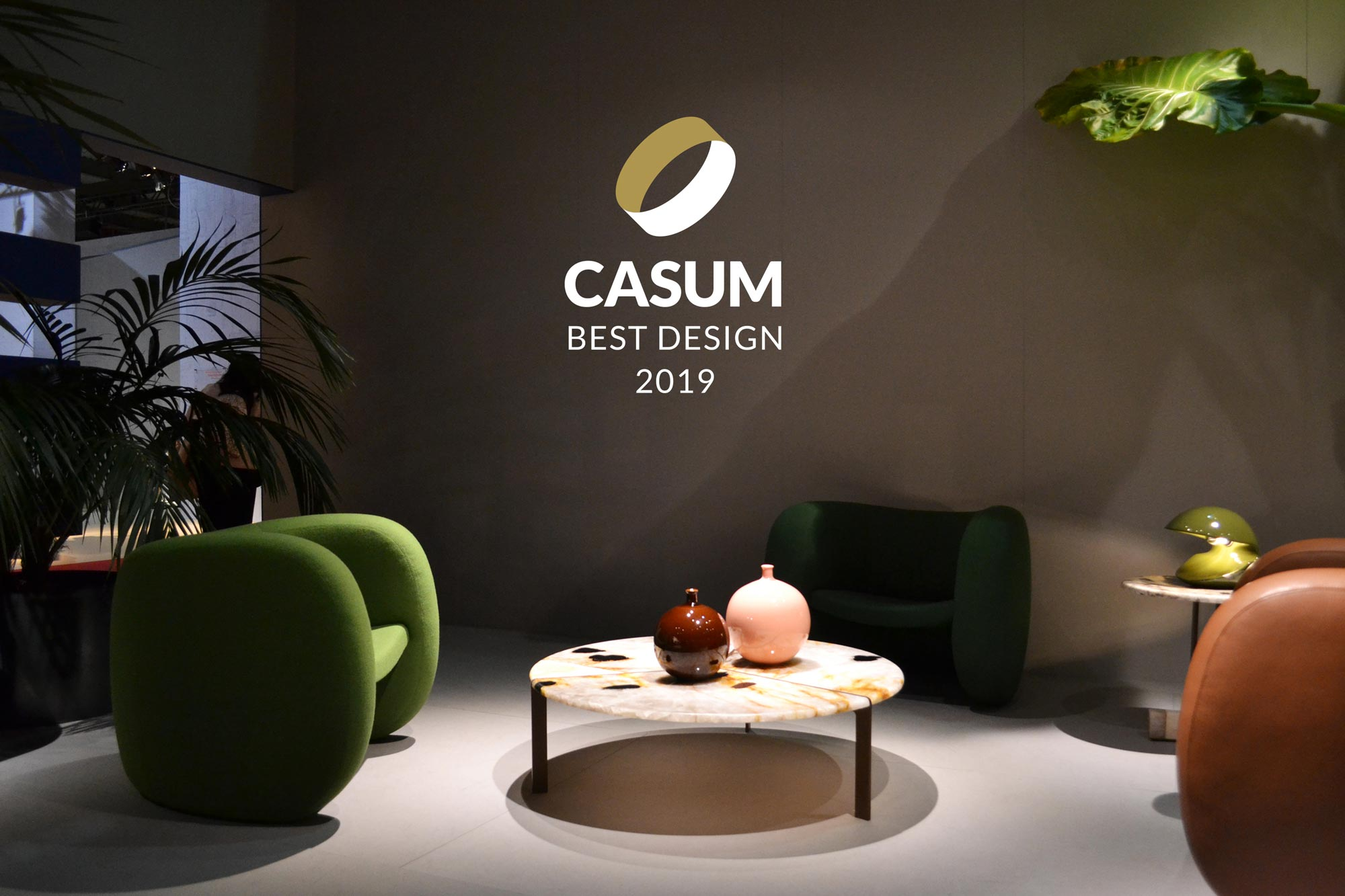 Casum Best Design 2019 winners. Tacchini booth with armchairs and coffee tables