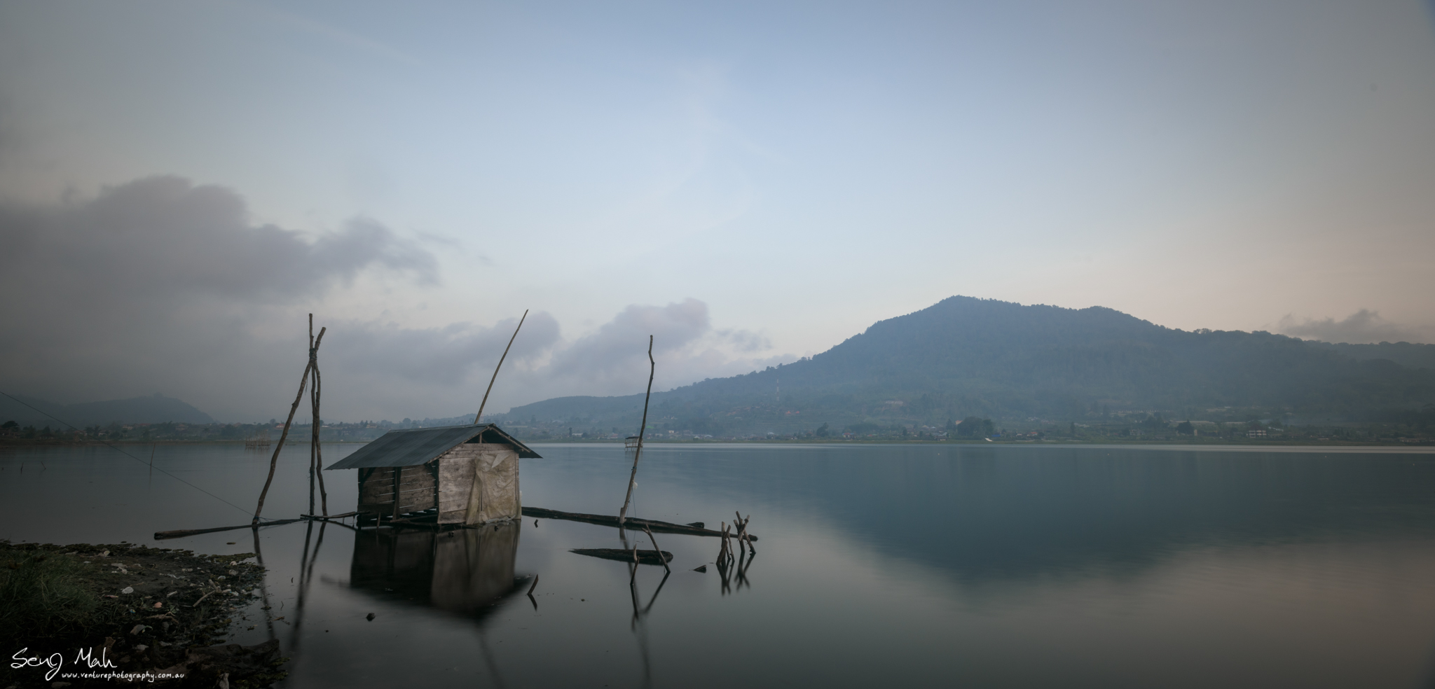 Lakeside scene in Bali with shack
