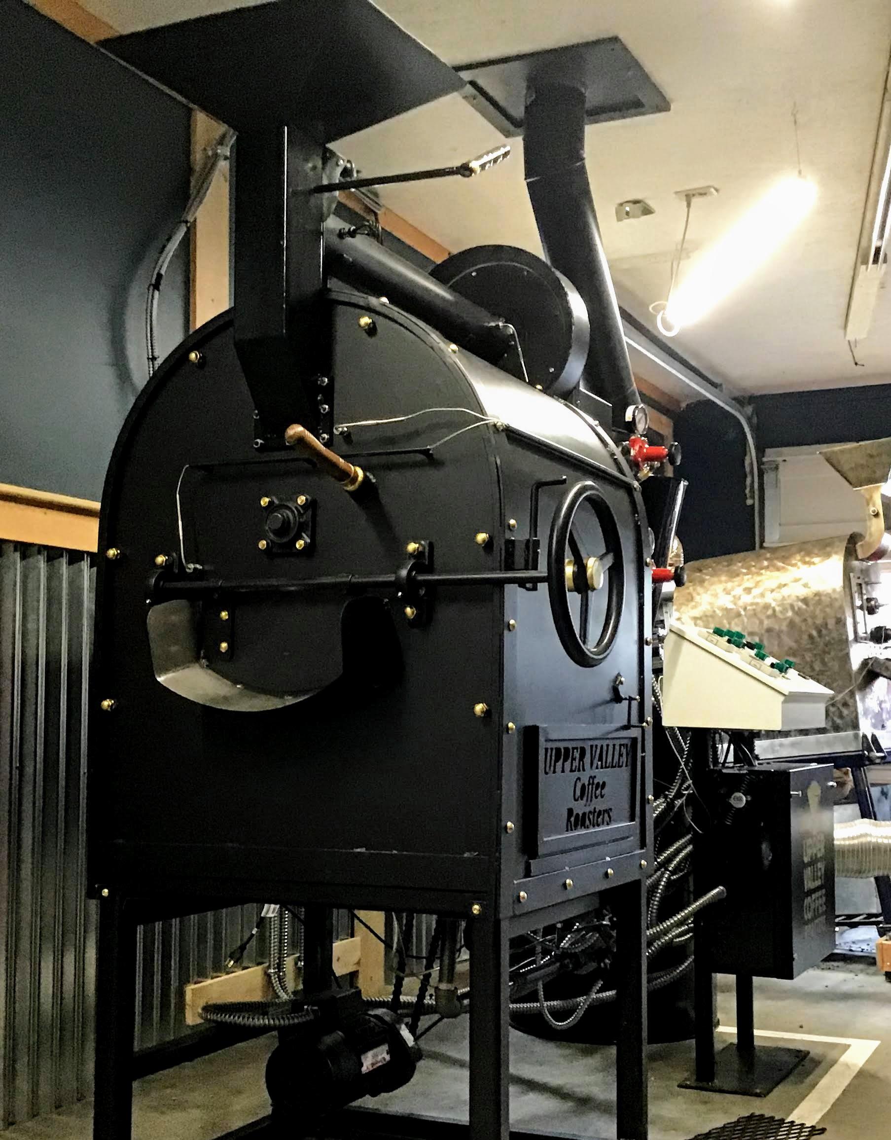 Black, steel drum roaster.