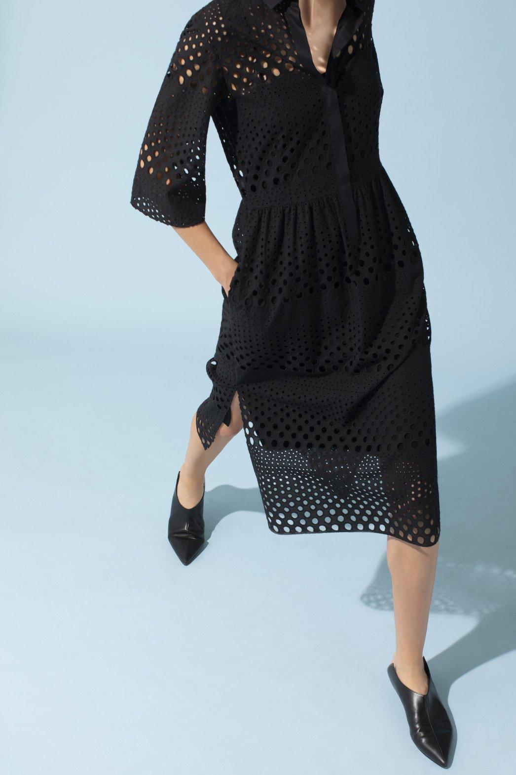 Women wearing a black designer dress with dots