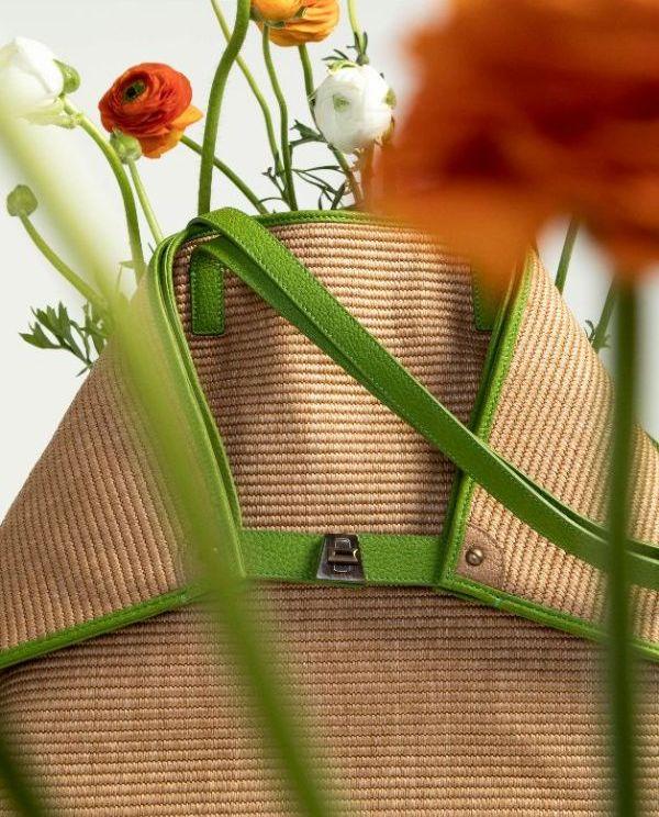 raffia bag from akris with trapezoid closure