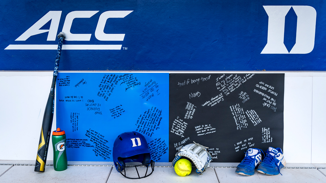 Duke Softball Bullpen with posters containing affirmations by the team