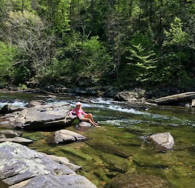 Rachelle Siegrist relaxing in the creek
