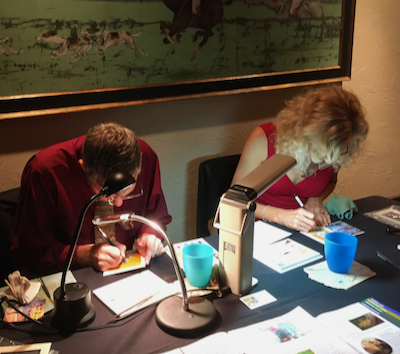 Wes and Rachelle Siegrist demonstrating their miniature painting techniques