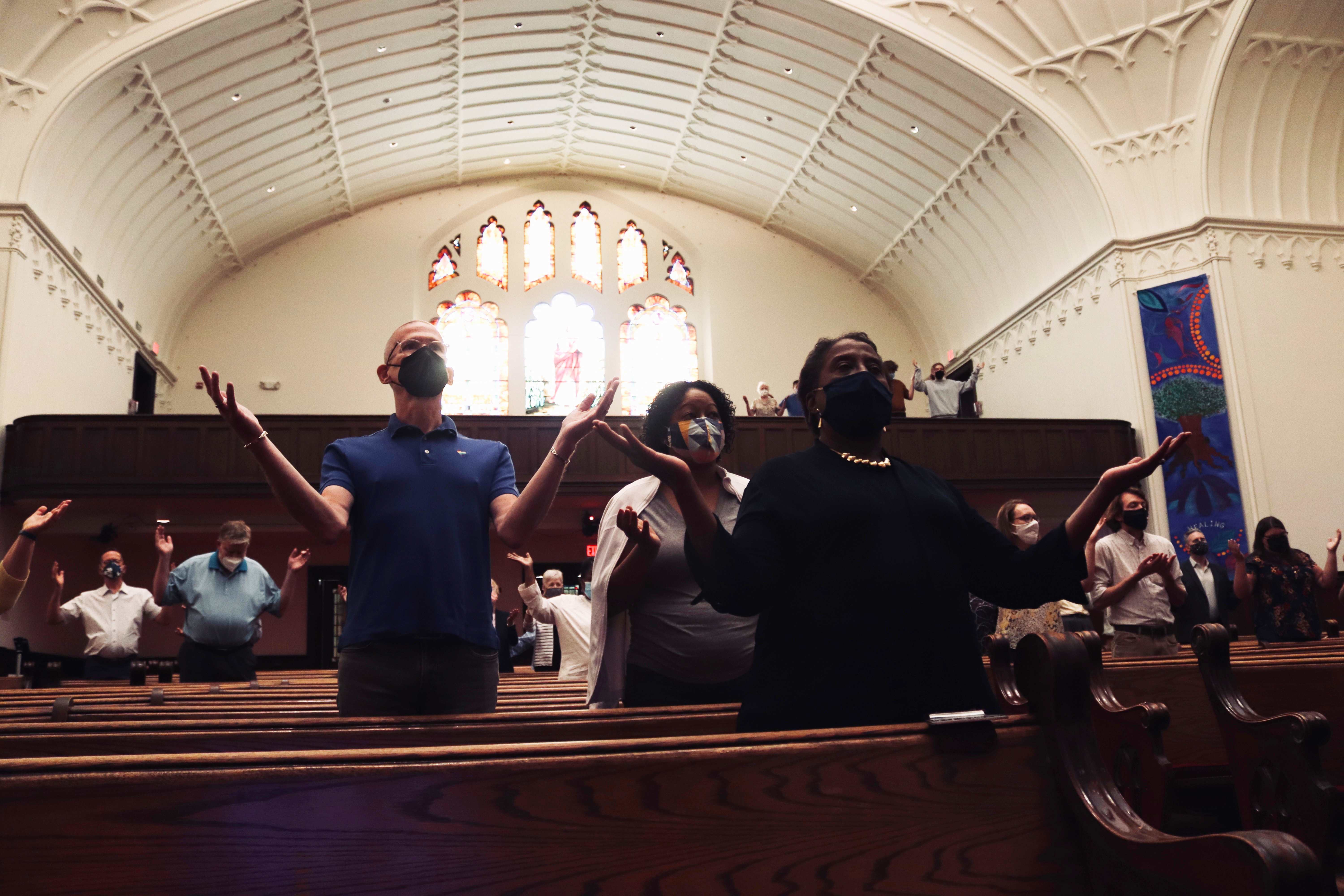 Foundry members and friends worshipping with masks on in our Sanctuary at 16th and P in Washington, D.C.