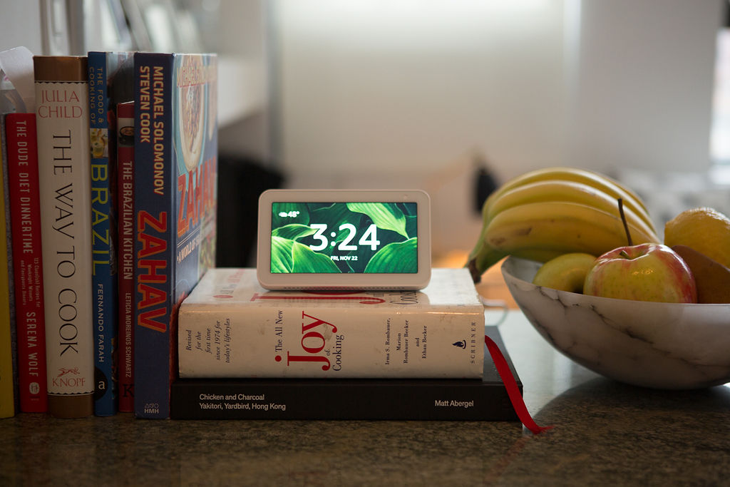 Echo Show 5 on a pile of cookbooks