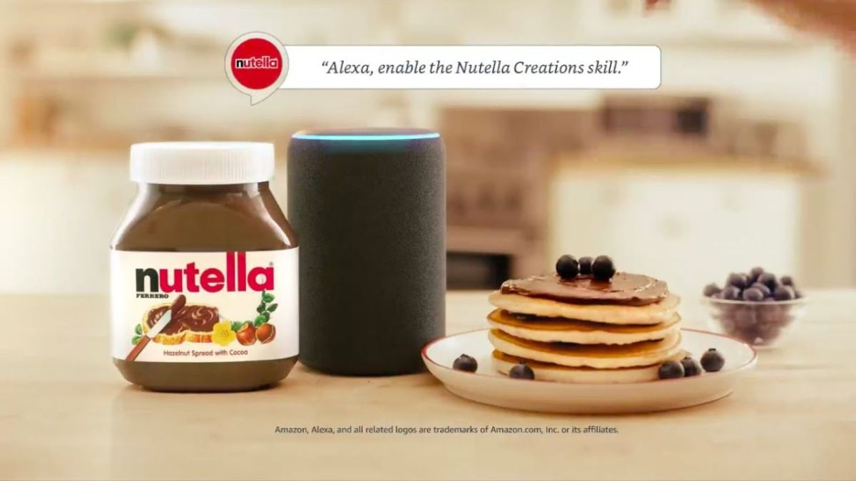 A stack of pancakes, jar of Nutella and Echo speaker on the kitchen counter