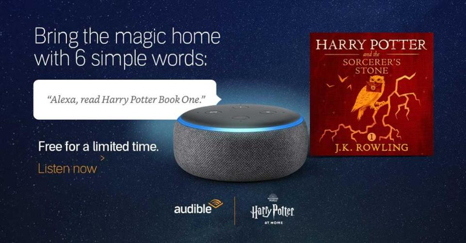 An Echo Dot next to Harry Potter and the Sorcerer's Stone